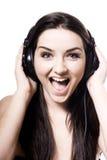 Girl listening to headphones Stock Photography