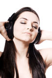 Girl listening to headphones Stock Images