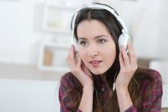 Girl listening to headphones royalty free stock photos