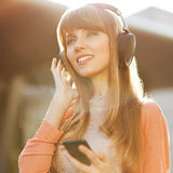 Girl listening to MP3 player Stock Images