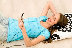 Girl listening to mp3 player Stock Photos