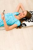Girl listening to mp3 player Royalty Free Stock Photo