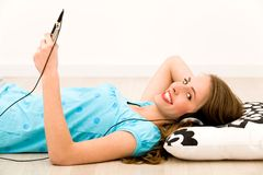 Girl listening to mp3 player Stock Photo