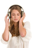 Girl listening to music with headphones Stock Image