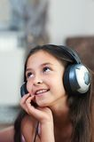 The girl is listening to music Stock Photo