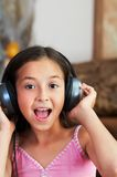 The girl is listening to music Royalty Free Stock Image