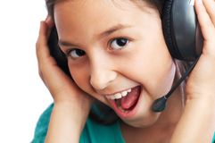 The girl  is listening to music Royalty Free Stock Photo