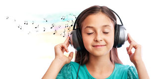 The girl listening to music. The girl  is  listening to music and close her eyes Royalty Free Stock Photos