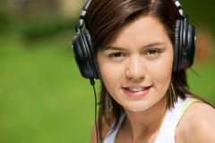Girl listening to music Stock Image