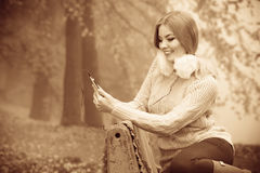 Girl listening to music in autumn park Royalty Free Stock Photography