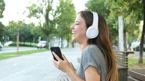 Girl listening to music and dancing in the street stock video