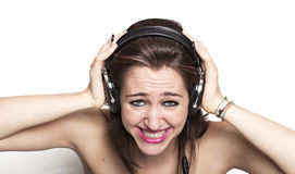 Girl listening to music and grinning Stock Image
