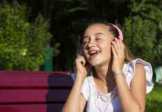 Girl listening to music on headphon Royalty Free Stock Image
