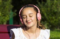 Girl listening to music on headphon Royalty Free Stock Photo