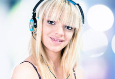 Girl listening to music with headphone. Close-up of Teenage girl listening to music with blue headphone Stock Images