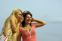 Girl listening to music with headphones Royalty Free Stock Photos