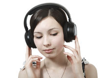 Girl listening to music on headphones Stock Images