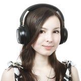 Girl listening to music on headphones Stock Photo