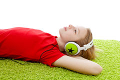 Girl is listening to music with headphones on Stock Photos