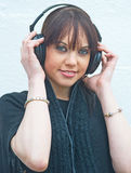 Girl listening to music with headphones. Royalty Free Stock Photography