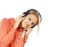Girl listening to music on headphones Stock Photography