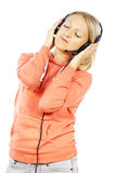 Girl listening to music on headphones Stock Photo