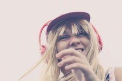Girl listening to music. On headphones royalty free stock photo