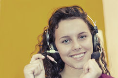 Girl listening to music with headphones Stock Photography