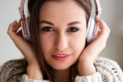 Girl listening to music with headphones. Front portrait of girl listening to music with headphones Royalty Free Stock Photos