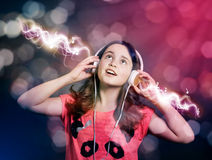 girl listening to music on headphones. Stock Photography