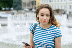 Girl listening to music with headphones Royalty Free Stock Image