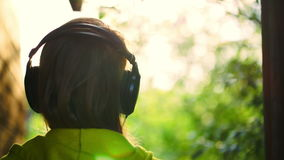 Girl listening to music in headphones outdoor Stock Photos