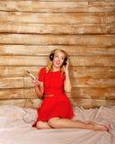 Girl listening to music on headphones Stock Image