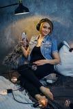 Girl listening to music on headphones Royalty Free Stock Image