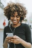 Girl listening to music from her phone stock photography