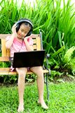 Girl listening to music from a laptop Royalty Free Stock Images