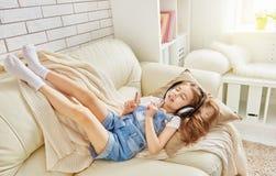 Girl listening to music Stock Image