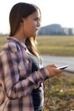 Girl listening to music, looking away Royalty Free Stock Photo