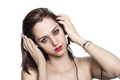 Girl listening to music and looking Royalty Free Stock Photos