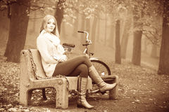 Girl listening to music mp3 relaxing in autumn park Royalty Free Stock Photography