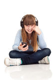 Girl listening to music on MP3 player Stock Photography