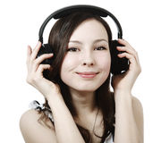 Girl Listening To Music On Headphones Royalty Free Stock Images