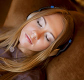 Girl listening to the music Stock Images
