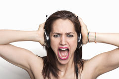 Girl listening to music and screaming Royalty Free Stock Photos