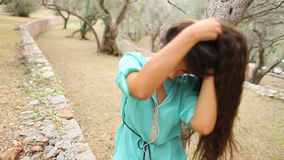 Girl listening to music and sing emotional and drive on smartpho stock video footage