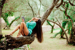 Girl listening to music and sing emotional and drive on smartpho. Long hair girl listening to music emotional and drive on smartphone mobile in green park forest Royalty Free Stock Images