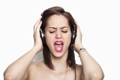 Girl listening to music and singing Royalty Free Stock Photo