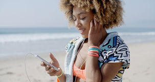 Girl Listening To The Music From A Smart Phone Stock Images