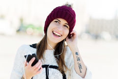 Girl listening to music on smartphone Royalty Free Stock Images