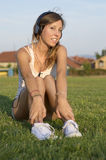 Girl listening to music on the soccer field. Training break Stock Photo